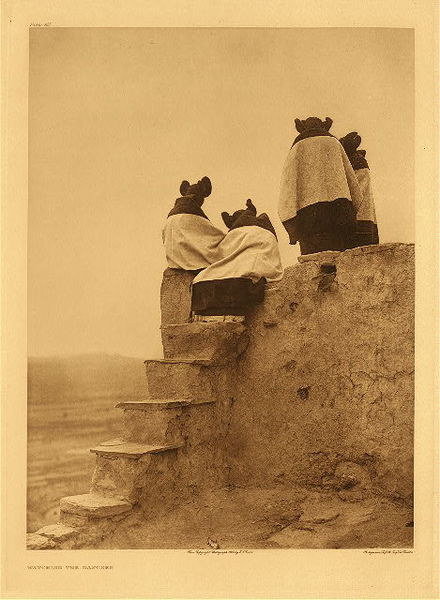 Edward S. Curtis -   Plate 405 Watching the Dancers border=