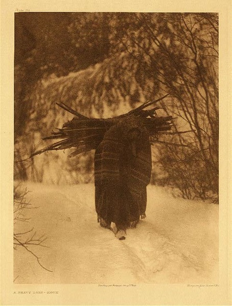 Edward S. Curtis -   Plate 100   A Heavy Load - Sioux border=