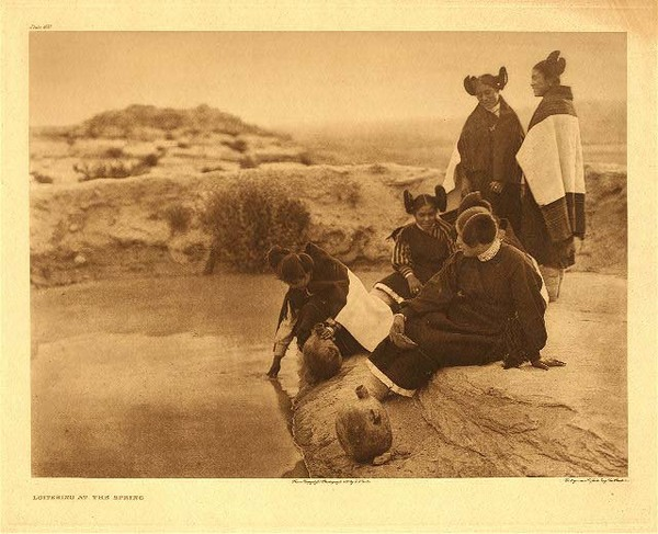 Edward S. Curtis -   Plate 400 Loitering at the Spring border=