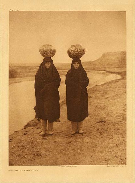 Edward S. Curtis -   Plate 610 Zuni Girls at the River border=