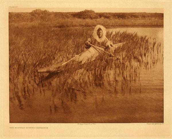 Edward S. Curtis -   Plate 714  The Muskrat Hunter - Kotzebue border=