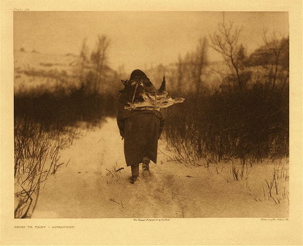 Edward S. Curtis -   Plate 126 Going to Camp - Apsaroke border=