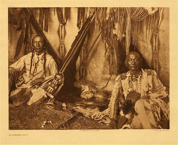 Edward S. Curtis -   Plate 188 In a Piegan Lodge border=