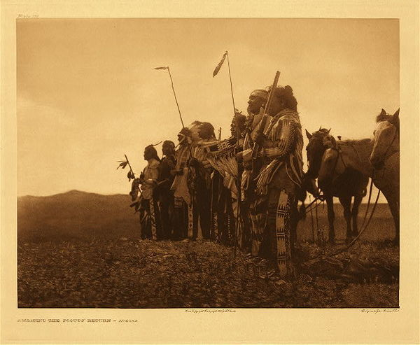 Edward S. Curtis - Plate 181 Awaiting the Scout's Return - Atsina border=