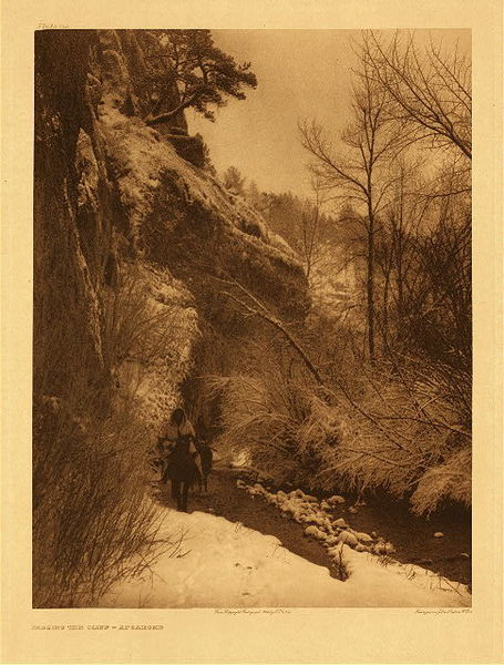 Edward S. Curtis -   Plate 132 Passing the Cliff - Apsaroke border=