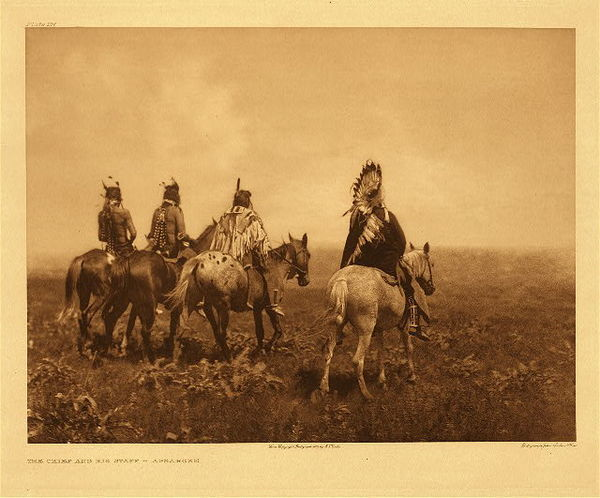 Edward S. Curtis - Plate 137 Chief and his Staff - Apsaroke border=