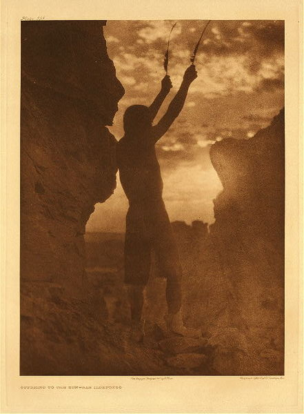 Edward S. Curtis -   Plate 592 Offering to the Sun - San Ildefonso border=