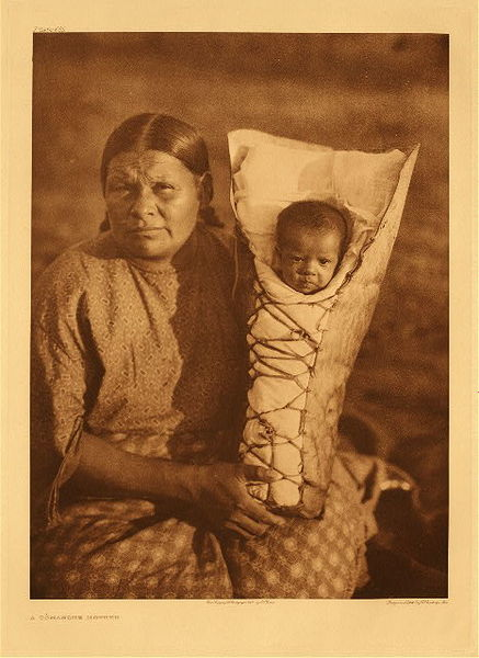 Edward S. Curtis - Plate 685 A Comanche Mother border=