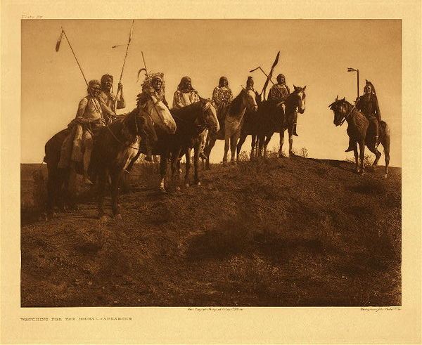 Edward S. Curtis -   Plate 116 Watching for the Signal - Apsaroke border=