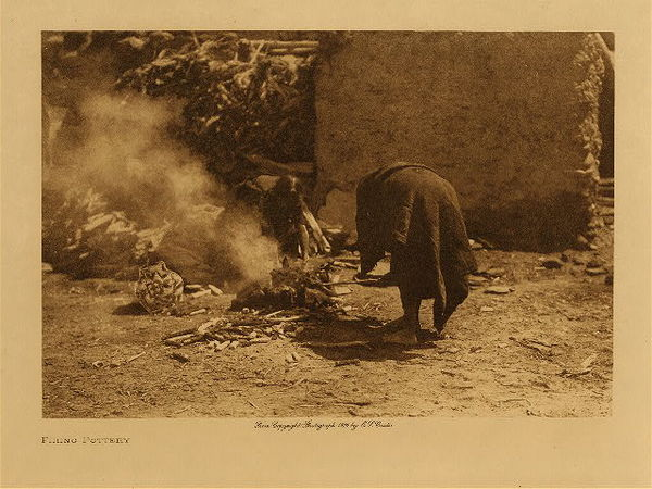 Edward S. Curtis - Firing Pottery border=