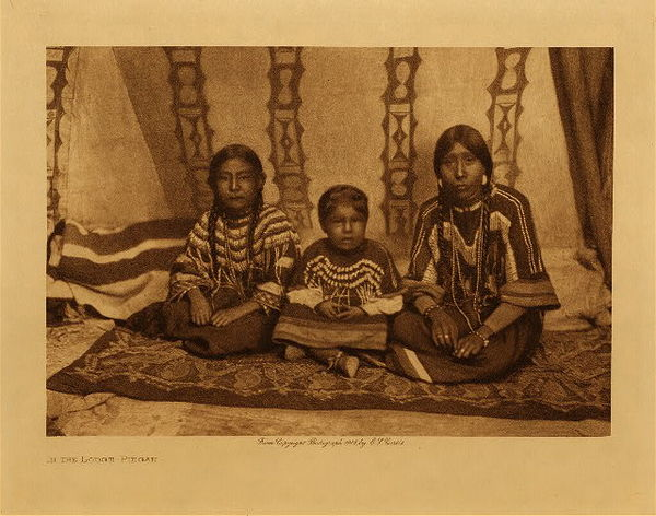 Edward S. Curtis - In the Lodge - Piegan border=