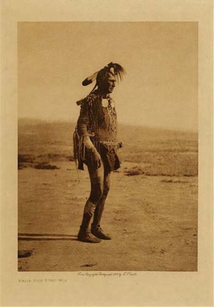 Edward S. Curtis - White Man Runs Him (Full Figure) border=