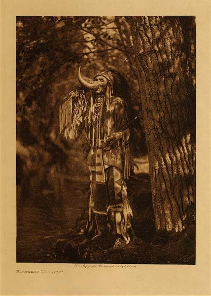 Edward S. Curtis - Flathead Warrior border=