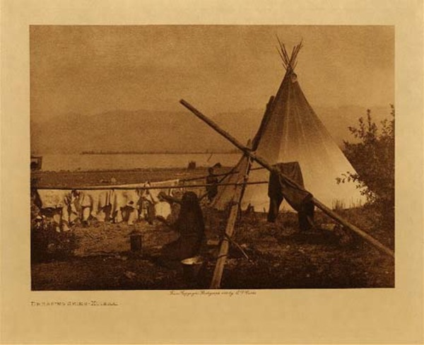 Edward S. Curtis - Dressing skins (Kutenai) border=