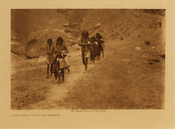 Edward S. Curtis - Flute Boys, Priest, and Maidens border=