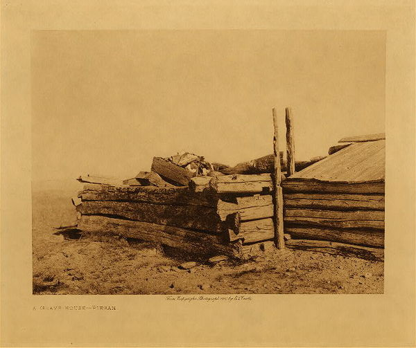 Edward S. Curtis - A Grave House - Piegan border=