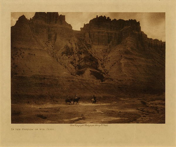 Edward S. Curtis - In the Shadow of the Cliff border=