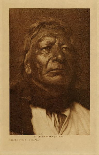 Edward S. Curtis - Stands First - Ogalala border=