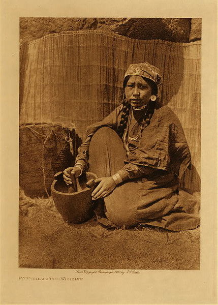 Edward S. Curtis - Pounding Fish - Wishham border=