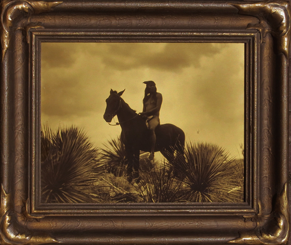 Edward S. Curtis - The Scout - Apache border=