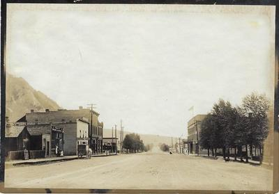 Title: Main Street with the Ivy Steam Laundry , Date: c. 1904 , Size: 5 x 7 inches , Medium: Silver Gelatin Photograph , Edition: Vintage