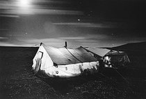 Title: Moon and Star Tracks Over Cook Tent , Date: 2001 , Size: 13 x 19 1/2 inches , Medium: Silver Gelatin Photograph , Signed: L/R , Edition: 35/125