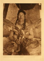 Title:   Plate 634 Placating the Spirit of a Slain Eagle - Assiniboin , Date: 1926 , Size: Portfolio, 22x18 inches , Medium: Vintage Photogravure , Edition: Vintage