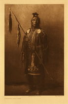 Title:   Plate 112 Apsaroke War - Chief , Date: 1908 , Size: Portfolio, 22 x 18 inches , Medium: Vintage Photogravure , Edition: Vintage