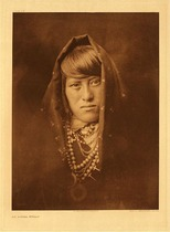 Title:   Plate 572 An Acoma Woman , Date: 1904 , Size: Portfolio, 22 x 18 inches , Medium: Vintage Photogravure , Edition: Vintage