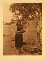 Title:   Plate 585 The Fruit Gatherer - San Ildefonso , Date: 1905 , Size: Portfolio, 22 x 18 inches , Medium: Vintage Photogravure , Edition: Vintage