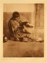 Title:   Plate 602 The Potter - Santa Clara , Date: 1905 , Size: Portfolio, 22 x 18 inches , Medium: Vintage Photogravure , Edition: Vintage