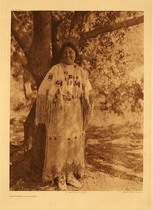 Title:   Plate 666  Cheyenne Costume , Date: 1927 , Size: Portfolio, 22 x 18 inches , Medium: Vintage Photogravure , Edition: Vintage