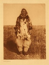 Title:   Plate 722  Kobuk Costume , Date: 1928 , Size: Portfolio, 22 x 18 inches , Medium: Vintage Photogravure , Edition: Vintage