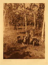 Title: Plate 630 Assiniboin Hunter , Date: 1926 , Size: Portfolio: 18 x 22.5 inches , Medium: Vintage Photogravure , Edition: Vintage