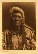 Title: Plate 229 A Flathead Chief , Date: 1910 , Size: Portfolio, 22 x 18 inches , Medium: Vintage Photogravure , Edition: Vintage
