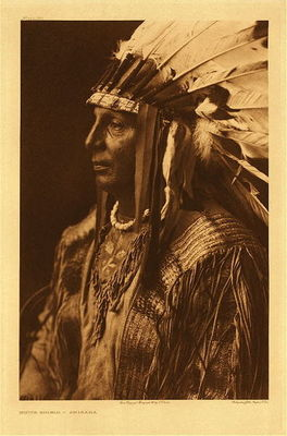 Title:   Plate 152 White Shield - Arikara , Date: 1908 , Size: Portfolio, 21 3/8 x 17 7/16 inches , Medium: Vintage Photogravure