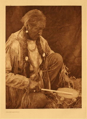 Title:   Plate 687  Peyote Drummer , Date: 1927 , Size: Portfolio, 22 x 18 inches , Medium: Vintage Photogravure