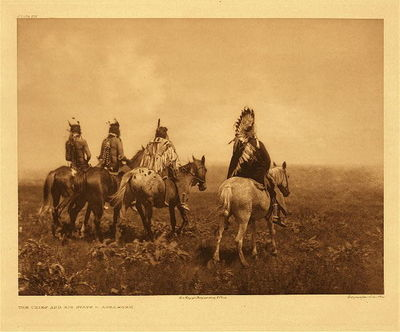 Title:   Plate 137 The Chief and His Staff - Apsaroke , Date: 1905 , Size: Portfolio, 18 x 22 inches , Medium: Vintage Photogravure , Edition: Vintage