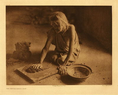 Title:      Plate 419 The Potter Mixing Clay , Date: 1921 , Size: 18 x 22 inches , Medium: Vintage Photogravure