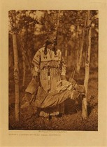 Title: Woman's Costume and Baby Swing - Assiniboin