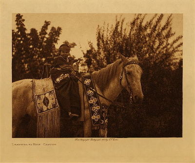 Title: Learning to Ride - Cayuse , Date: 1905 , Size: Volume, 9.5 x 12.5 inches , Medium: Vintage Photogravure , Edition: Vintage