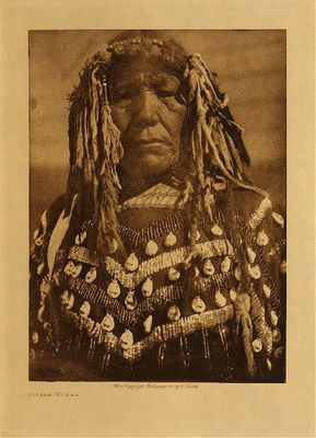 Title: Piegan Woman , Date: 1910 , Size: Volume, 9.5 x 12.5 inches , Medium: Vintage Photogravure , Edition: Vintage