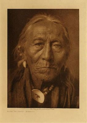 Title: Hunts the Enemy - Apsaroke , Date: 1908 , Size: Volume, 12.5 x 9.5 inches , Medium: Vintage Photogravure , Edition: Vintage
