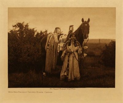 Title: With Her Proudly Decked Horse - Cayuse , Date: 1910 , Size: Volume, 9.5 x 12.5 inches , Medium: Vintage Photogravure , Edition: Vintage
