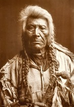 Title: Flathead Chief , Date: 1900 , Size: 15 1/2 x 10 3/4 inches , Medium: Gelatin Printing Out Print , Signed: L/L , Edition: Vintage