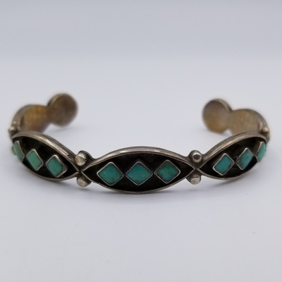 Title: Bracelet: Navajo Silver and 15 Diamond Shaped Green Turquoise Stones , Date: c 1950 , Medium: Sterling Silver , Edition: Vintage