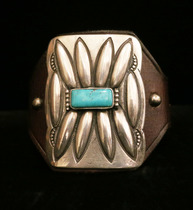 Title: Ketoh: Silver and Turq. Mounted on French Bridle Leather , Size: 2 1/4 x 1 5/8 inches