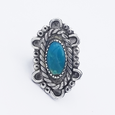 Title: Ring: Oval Stone Surrounded by Silver Ribboning and Designs , Size: 6 , Medium: Sterling Silver , Edition: Vintage