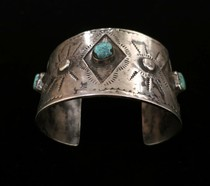 Title: Bracelet: Navajo Cuff with Three Stones and Stamping , Size: Width: 1 3/4 inches , Medium: Sterling Silver , Edition: Vintage