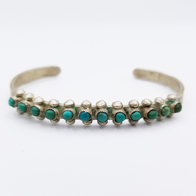 Title: Bracelet: Zuni Single Row Turquoise and Sterling , Size: 1/4 inch wide , Medium: Sterling Silver , Edition: Vintage